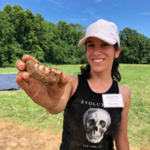 Excited student shows her archeological findings