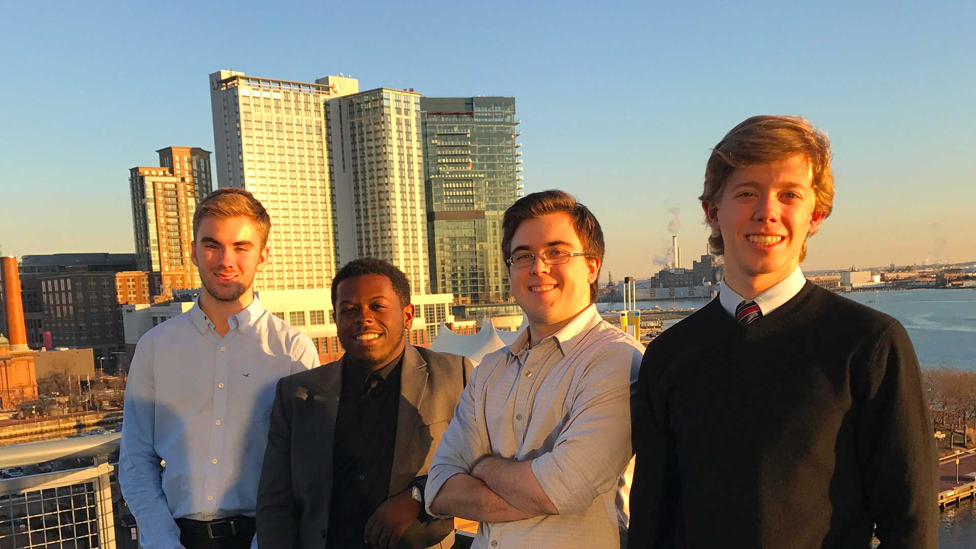 SMCM interns on a rooftop with a city backdrop.