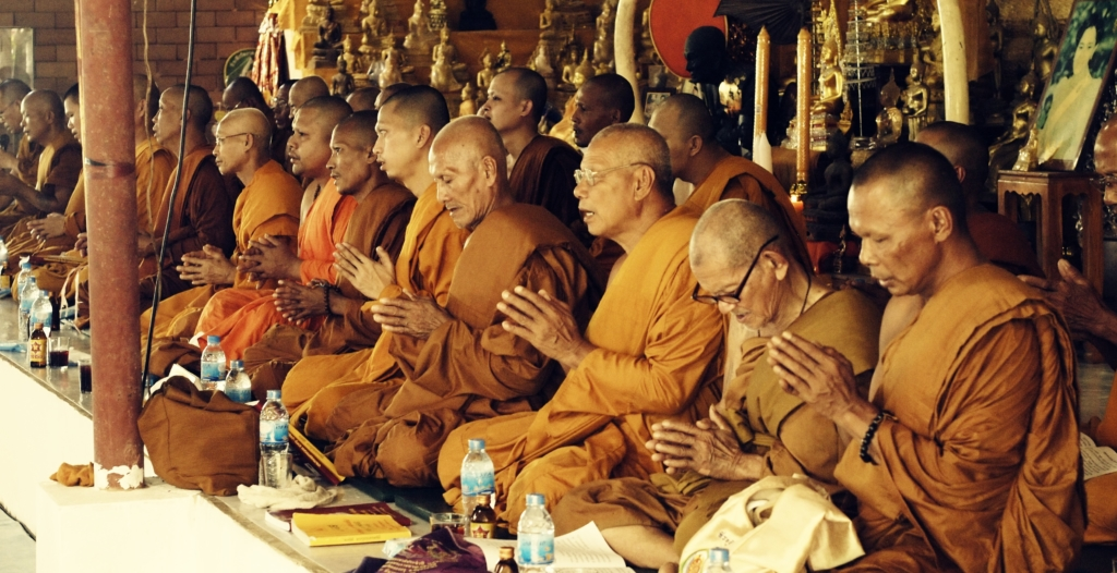 image of a group of monks praying