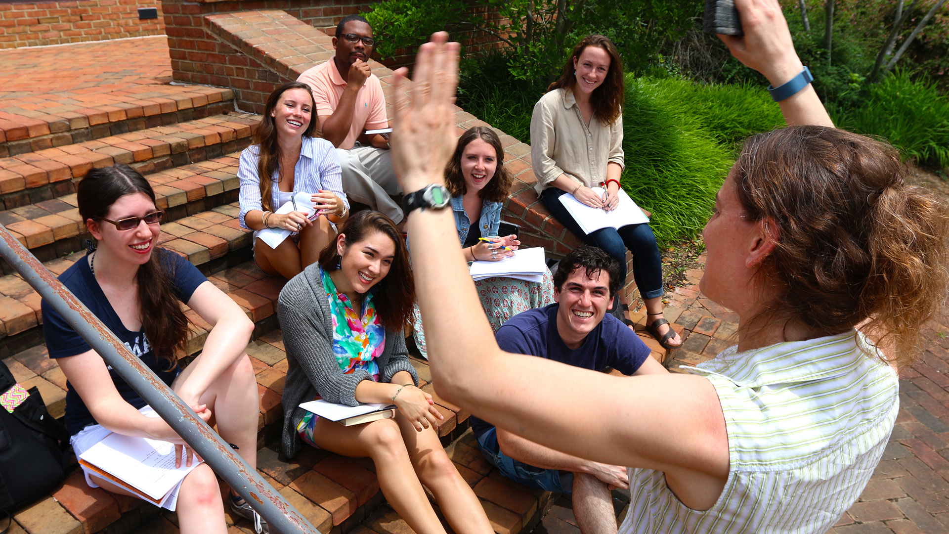 SMCM students enjoy an outdoor class on the brick steps near the science department.