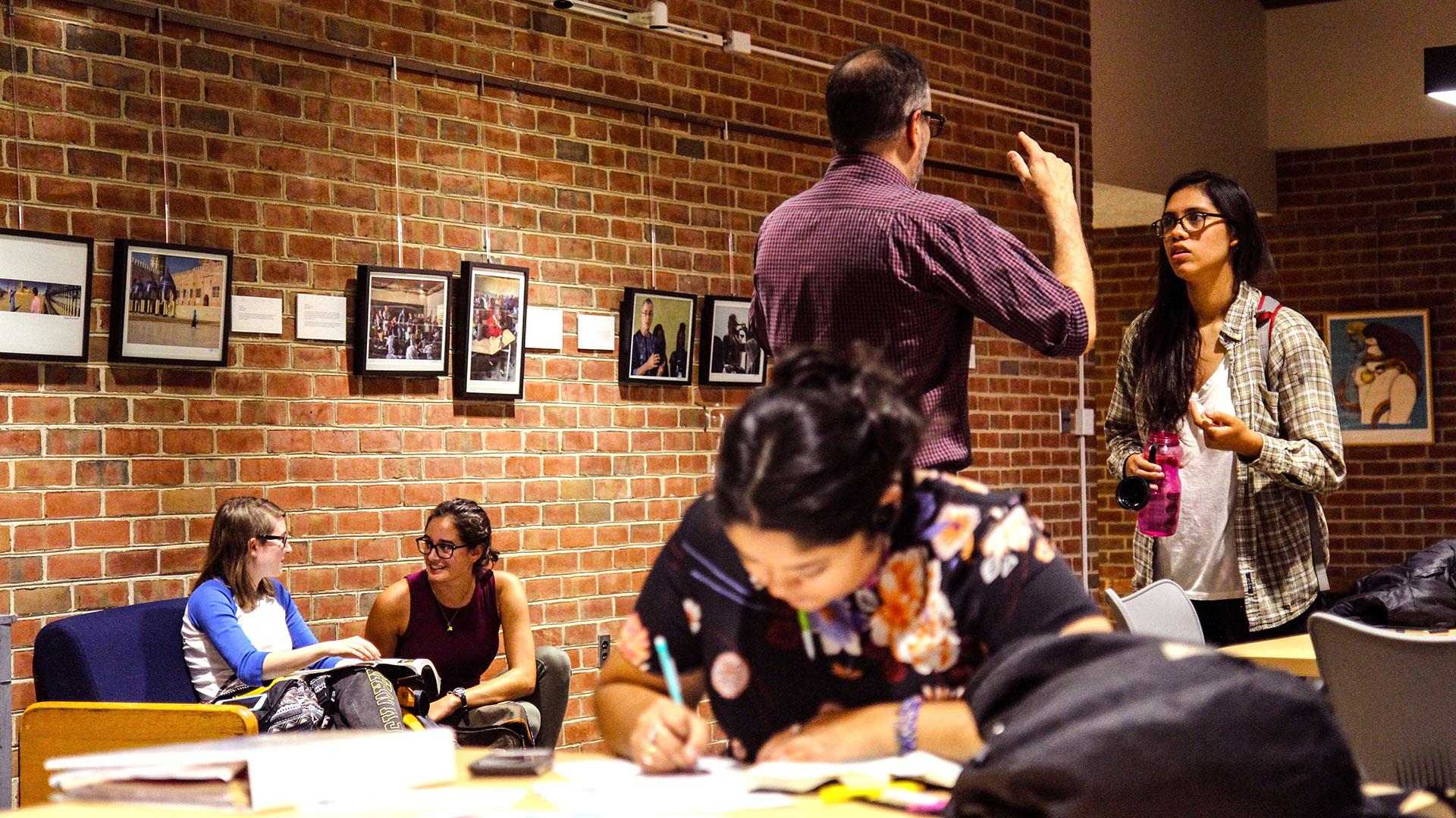 SMCM students study in Montgomery Hall second floor common area.