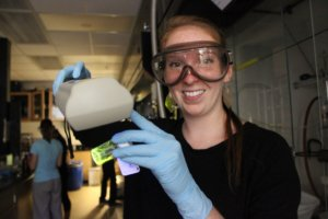 Marilyn Renata Steyert, an undergraduate fellow performing an experiment in a science lab