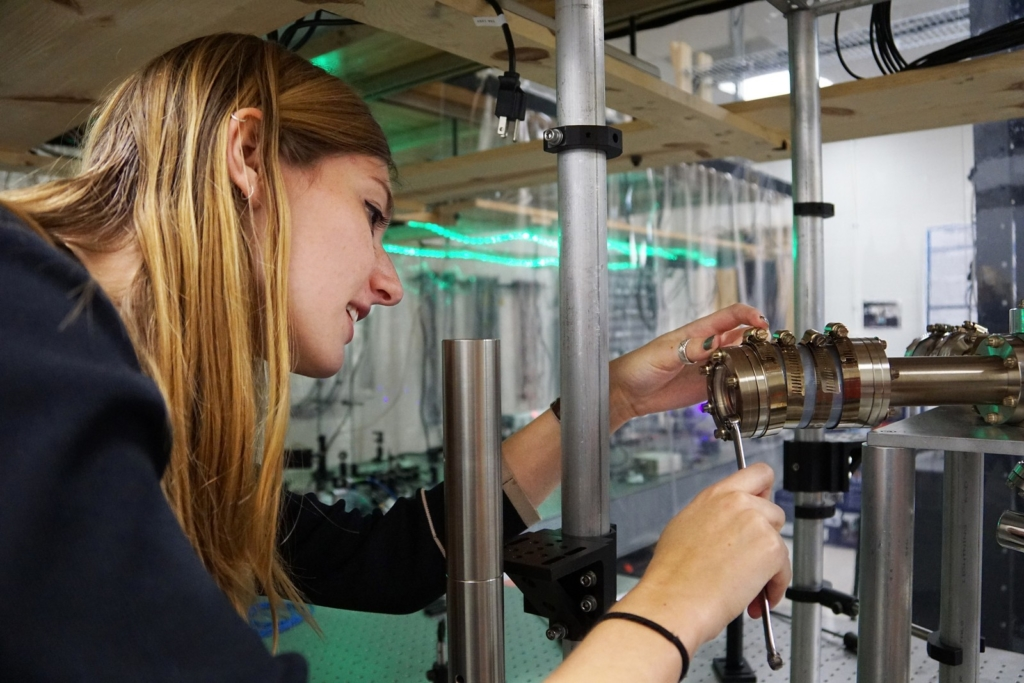 a student working on an electrical device for a physics project.
