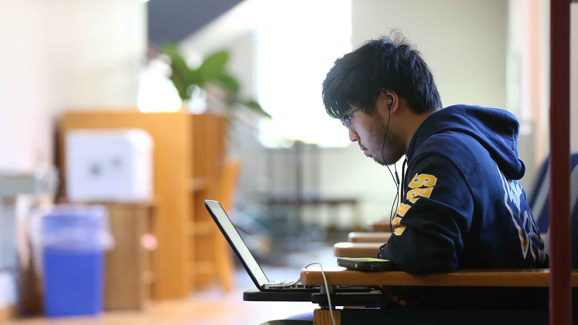 SMCM student studying in the library