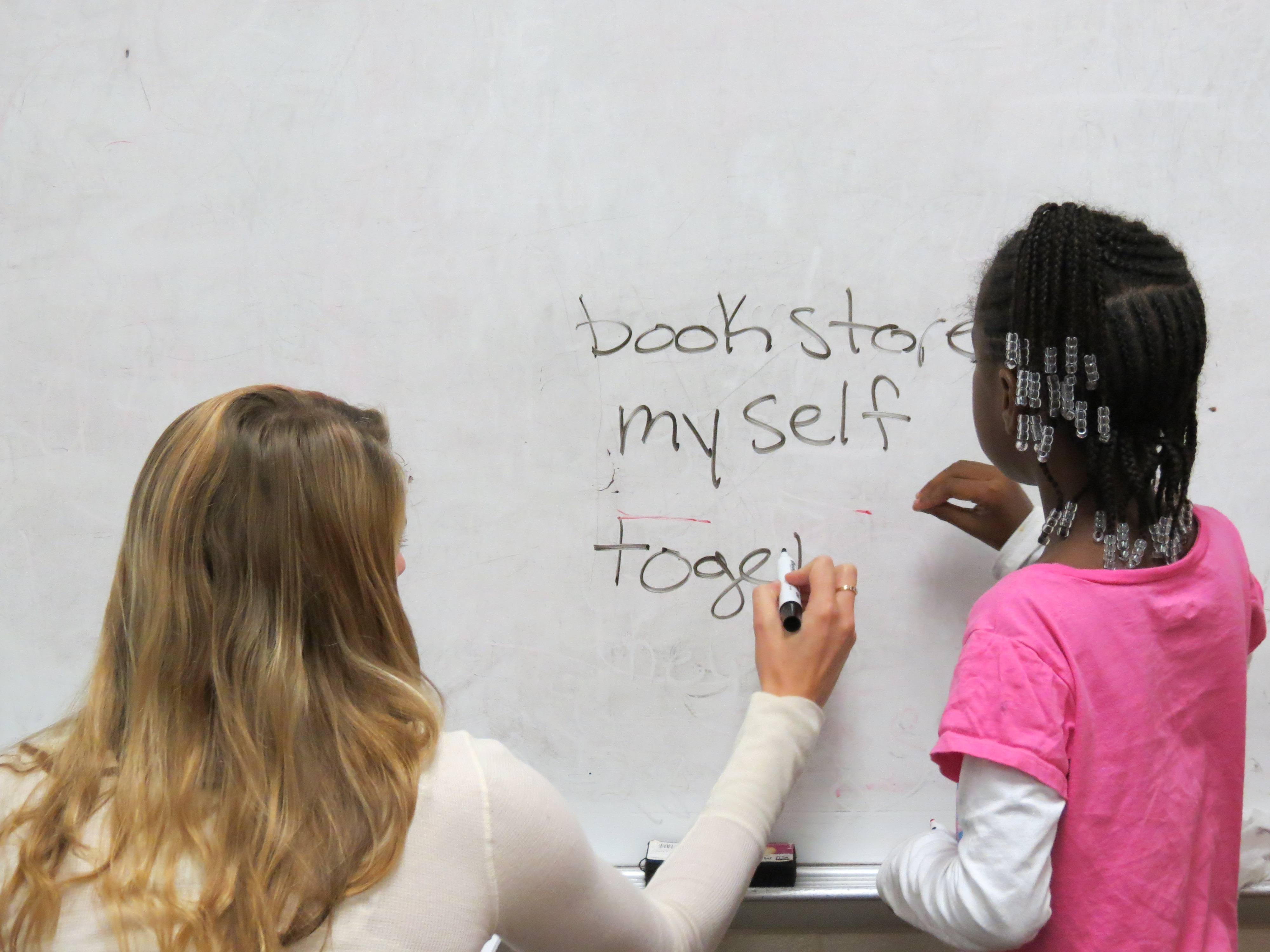 Become a teacher admissions alta young student learns how to write a professor stands next to her at the whiteboard 1betcityfo Image collections