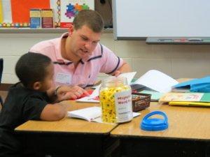 An MAT student teaching a single student