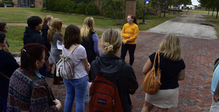 Prospective students explore campus with a student admissions guide