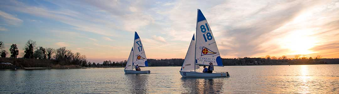 Two SMCM Varsity Sailing boats on the St. Mary's River.