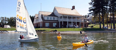 Boathouse featuring sailboat and kayakers