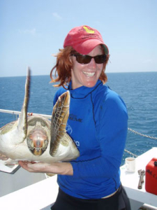 Dr. Qamar Schuyler with a sea turtle
