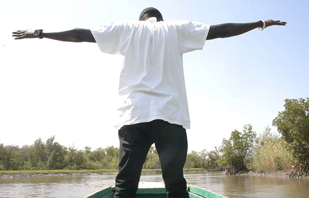 Student on a boat in The Gambia