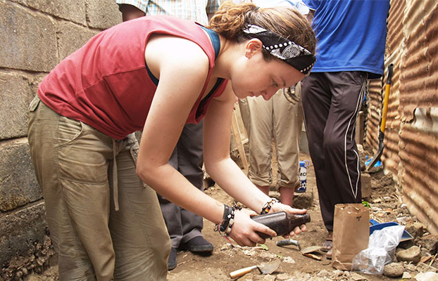 Student looking at a bottle in The Gambia