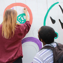 Students painting wall