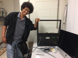 Dan Hunt '19 displays instrumentation he is constructing for the SMCM radio telescope.