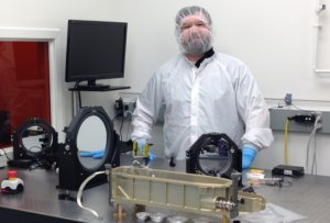Paul Stysley in clean suit with laser