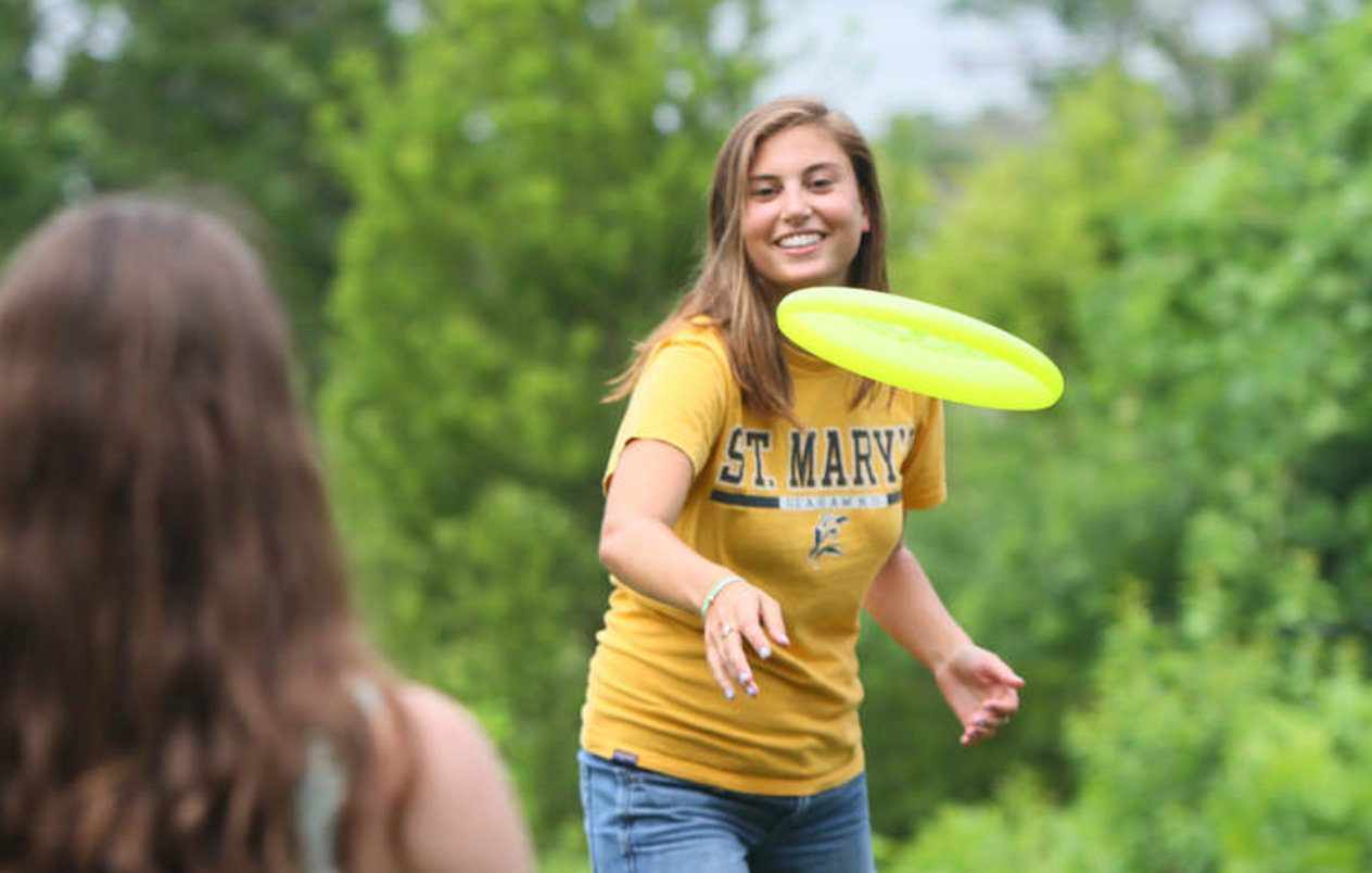 image showing two students throwing frisbees