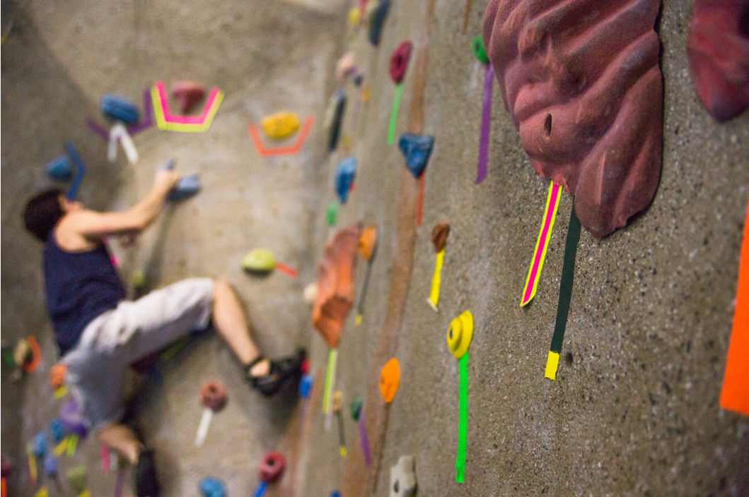 A student rock climbing at the SMCM ARC