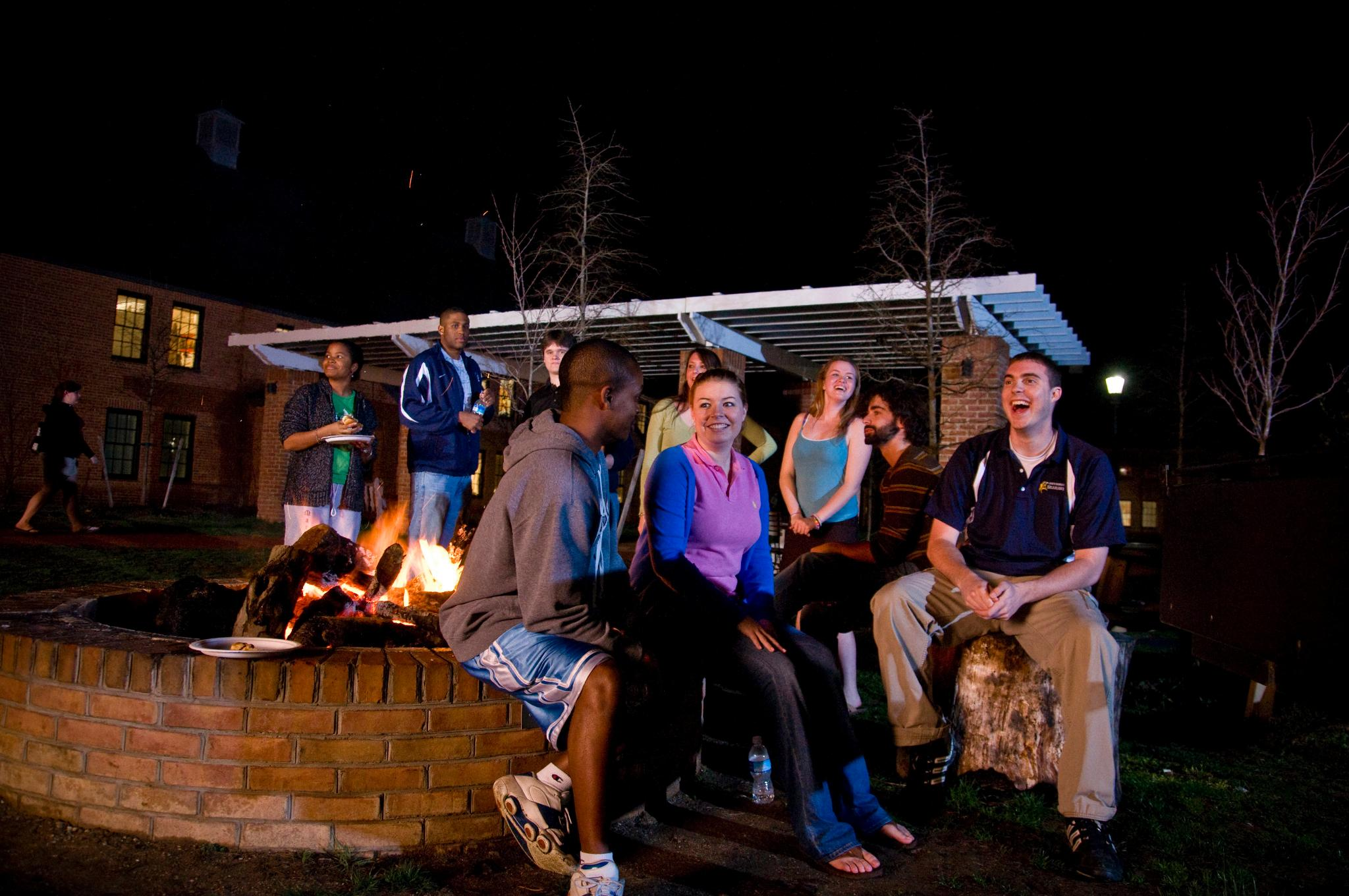 A group of students hanging out at the fire pit