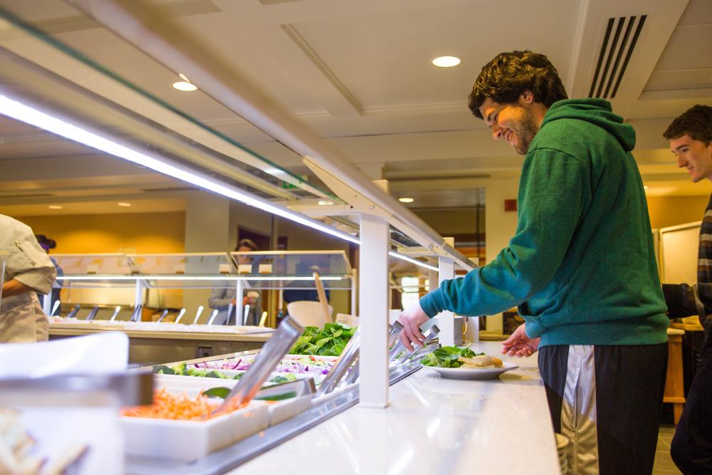 student at salad bar