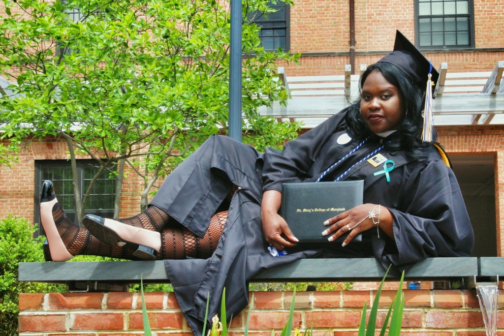 Proud African American Graduate in ap and gown