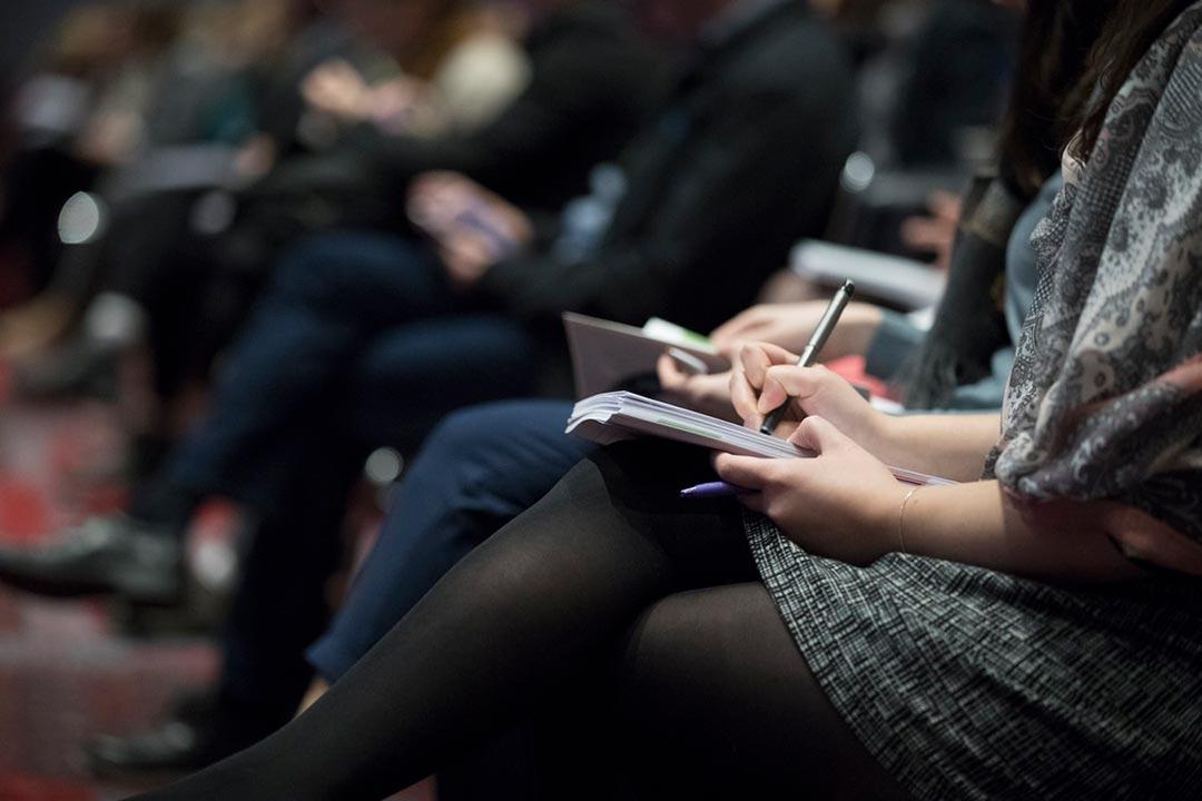 photo illustration: taking notes at a conference, workshop or presentation