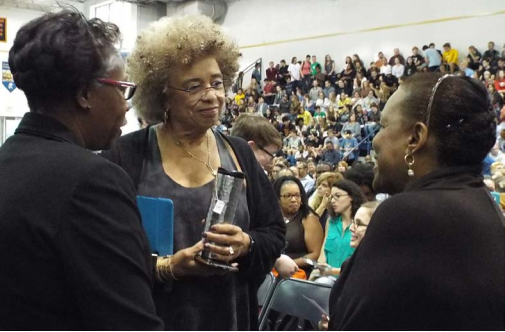 President of St. Mary's College, Dr. Tuajuanda C. Jordan and Angela Davis talk with Betty Currie, the former personal secretary for Bill Clinton.
