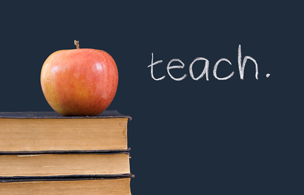 """teach"" written on blackboard, apple, books"