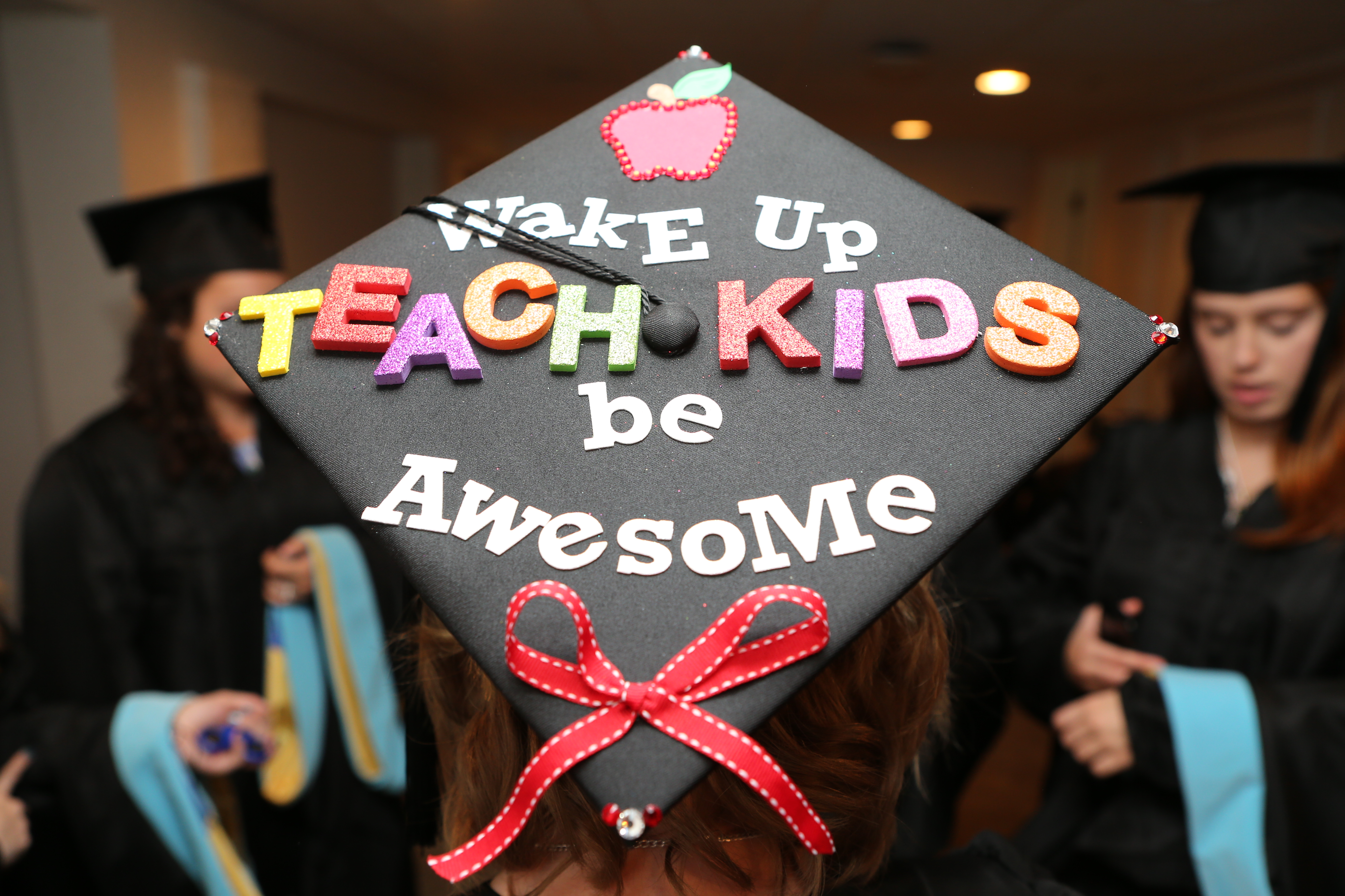 an image of a student's graduation cap with the following words attached on top: