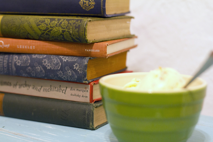 Books next to a bowl of food