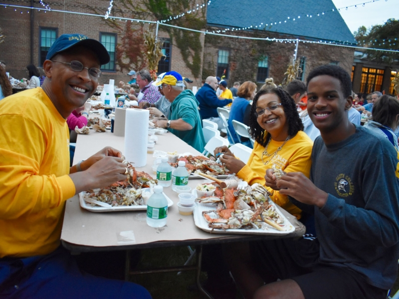 Family of three enjoys crabs during Hawktoberfest