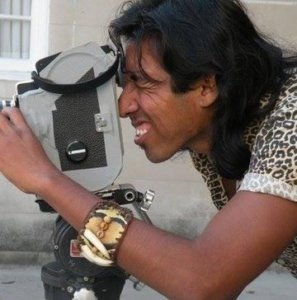 Filmmaker Alvaro Sarmiento peering through a film camera