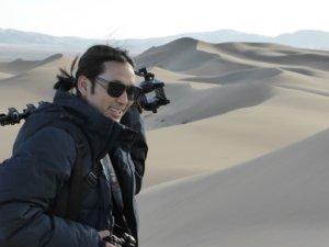 Filmmaker Stanzin Dorjai standing in a desert