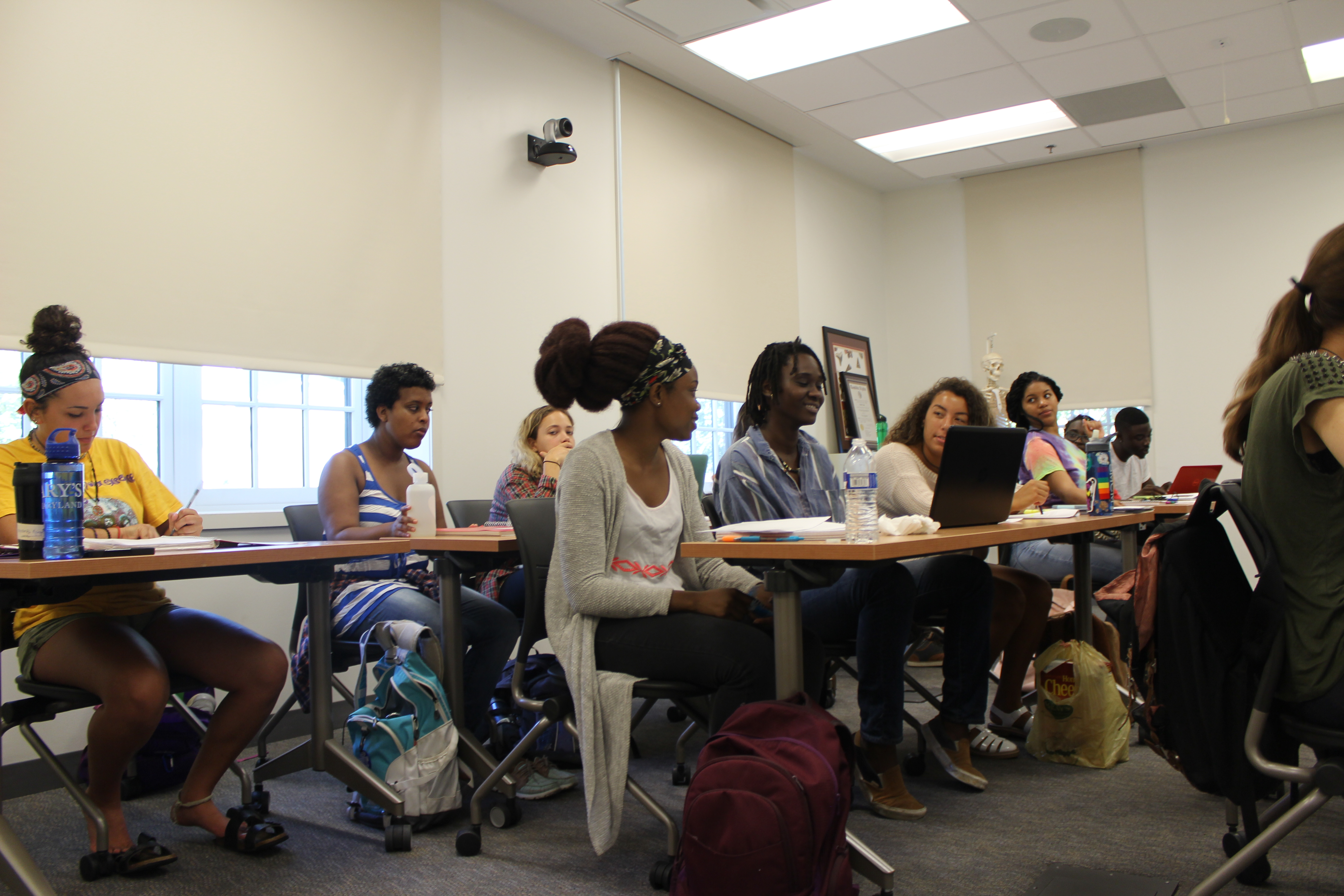 SMCM students talking in a classroom at Anne Arundel Hall