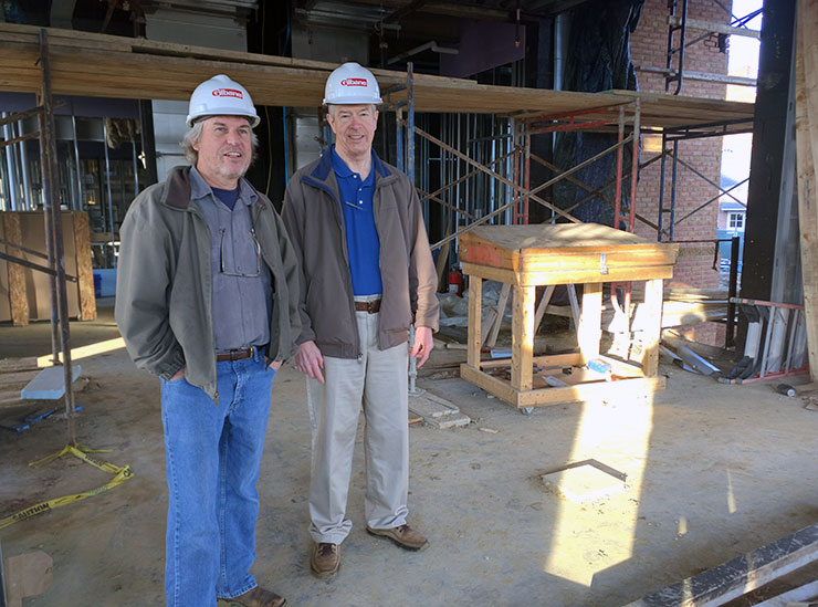 Robert Brown and Donald Wince in hard hats standing on the construction site of Anne Arundel Hall