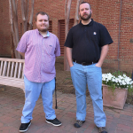 Photo of Will Looney and Josh Wilcox standing in front of the Library.