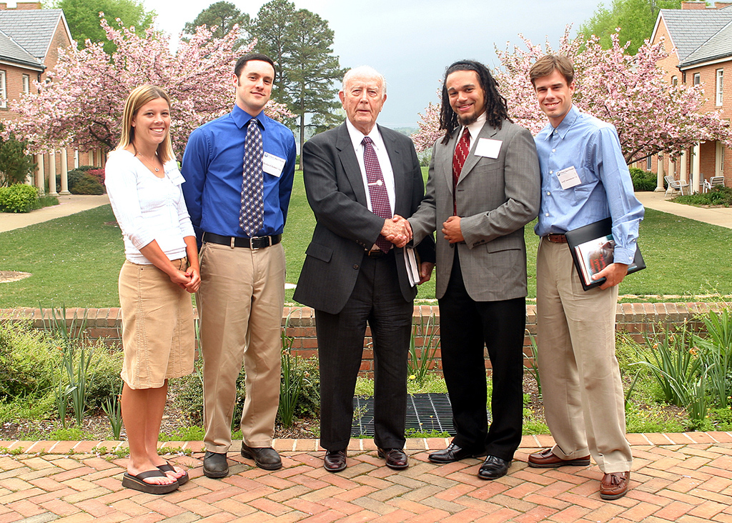 Gov. Schaefer with St. Mary's College of Maryland interns, from left, Judy Gallagher '04, Richard Romer '04, Robert White '04, and Geoffrey Sanzenbacher '05.