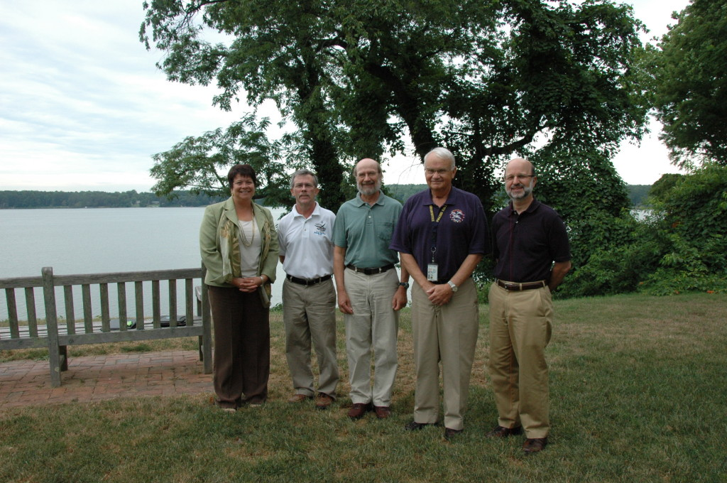 Projects by science students at St. Mary's College of Maryland will be funded by charitable donations from the new Cove Point Natural Heritage Trust Ruth Mathes Scholarship Program. From left, Maureen Silva, vice president for advancement; Bob Boxwell, executive director of the Cove Point; Chris Tanner, biology professor; Michael Rudy, board president of the Cove Point; and St. Mary's College President Joseph Urgo. (Photo by Lee Capristo)
