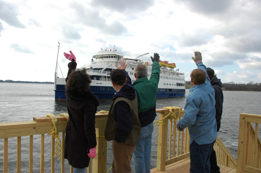 St. Mary's College of Maryland staff wave farewell Sunday to the Sea Voyager, which housed 240 SMCM students for almost two months. (Photo by Lee Capristo)