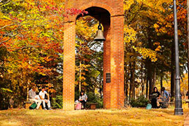 Students near Bell Tower in fall