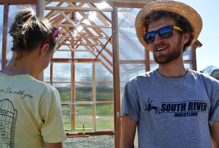 Kersey '15 (right) helping to build the Campus Farm greenhouse as a volunteer
