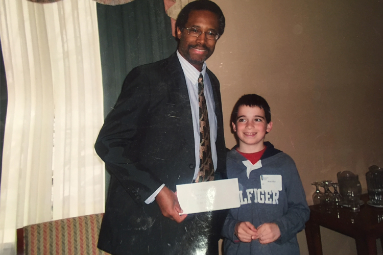 Flyr (at age 10) with 2016 Republican presidential candidate Dr. Ben Carson (left).
