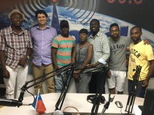 Group of people at a Haitian radio station