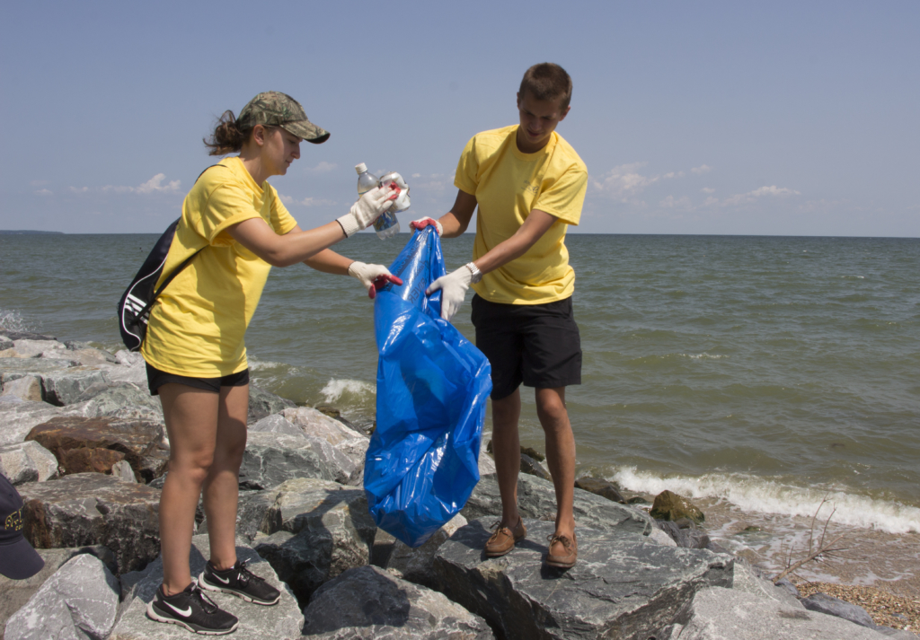 to students pick up trash at Point Lookout State Park