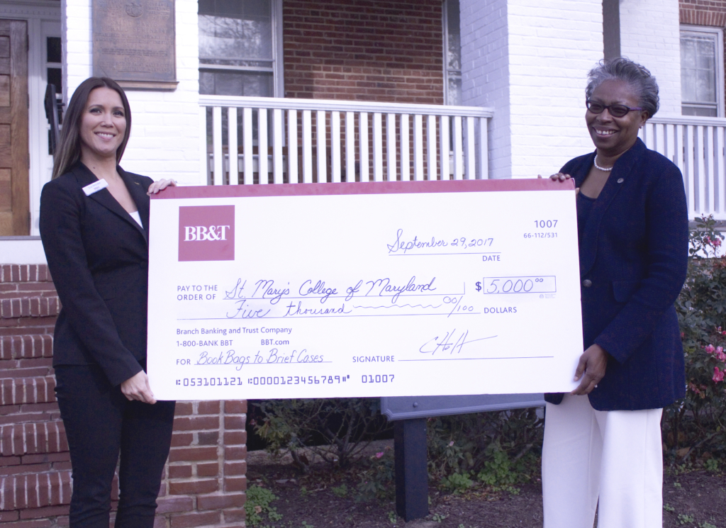Tuajuanda C. Jordan, president of St. Mary's College of Maryland (right), accepts a check for the Bookbag to Briefcase program from BB&T. The check was presented by Elizabeth Snyder, vice president at BB&T, St. Mary's County region.