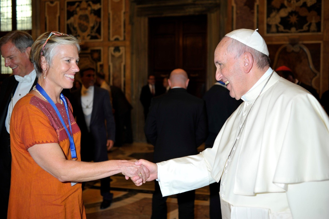 A smcm instructor shaking hands with the Pope