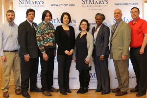 A picture of the professors with CEO, Kurt Heckman