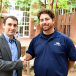 Dr Troy Townsend and Solar Tech project manager Jeff Croisetiere shake hands