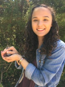 SMCM student Elizabeth Johnson holds a white-throated sparrow