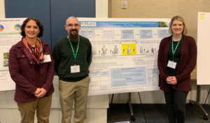 Doctors Mertz, Bowers, and Neiles stand in front of their CUR poster