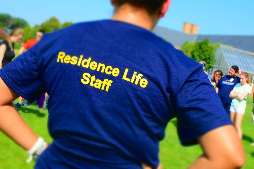 Residence Life Staff Member at training day wearing staff tshirt